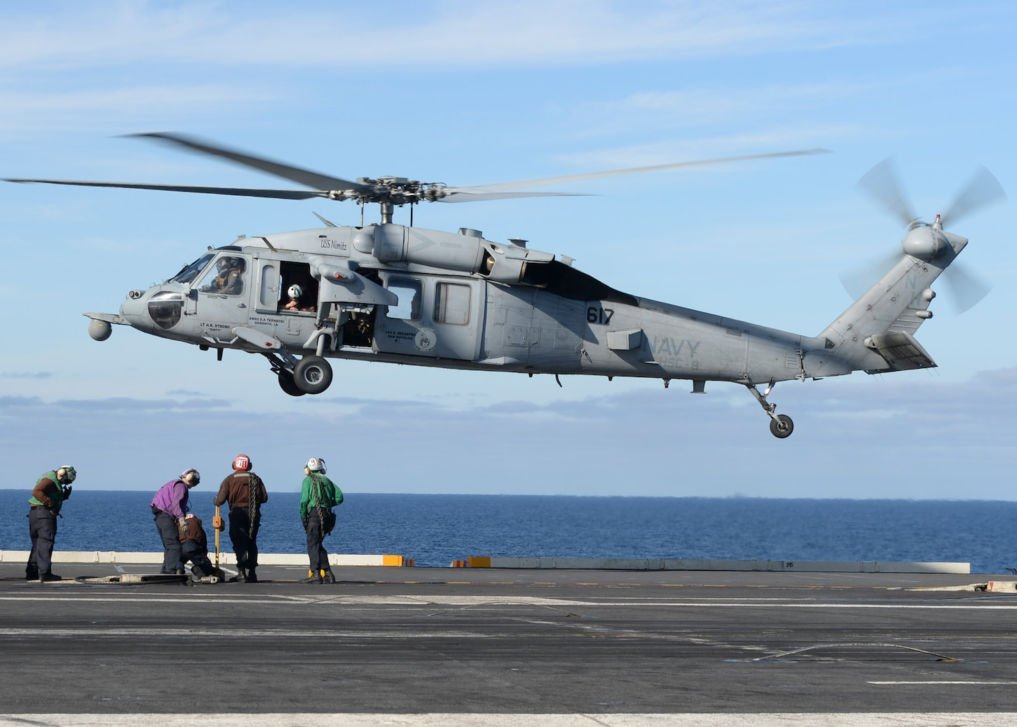"""An MH-60ss Sea Hawk helicopter, from the """"EightBallers"""" of Helicopter Sea Combat Squadron (HSC) 8, prepares to land aboard USS Nimitz (CVN 68)."""
