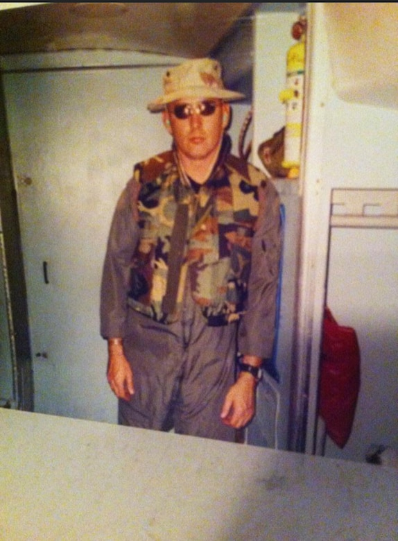 """Then Tech. Sgt. Bryan """"Skip"""" Ford, 512th Aircraft Maintenance Squadron flying crew chief, poses for a photo in the crew relief area of a C-5 Galaxy at Dover Air Force Base, Delaware, in late 2001. Ford recently recalled the events of Sept. 11, 2001, while stationed at Dover AFB and how 9/11 changed how he viewed our relative security and freedom as a nation. (Courtesy photo)"""