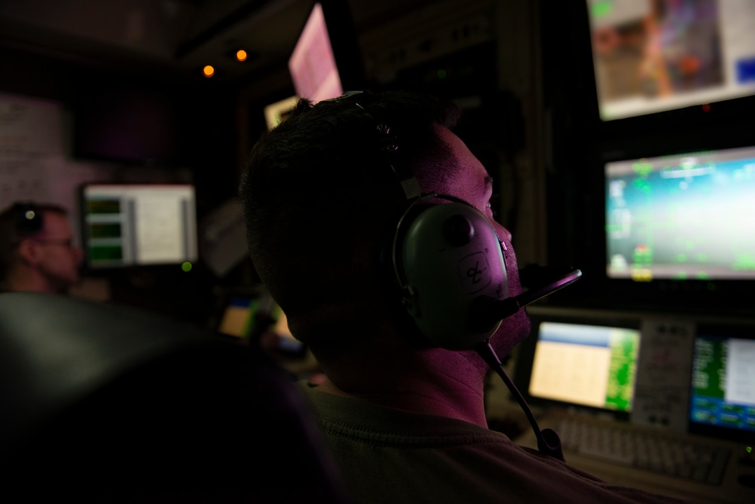 A photo of an Airman looking at a screen
