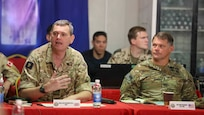 British Army Brig. Gen. Richard Bell, Combined Joint Task Force Operation Inherent Resolve (CJTF-OIR) deputy commander, speaks to ambassadors of joint partner nations during Ambassadors' Day in Baghdad, Iraq.