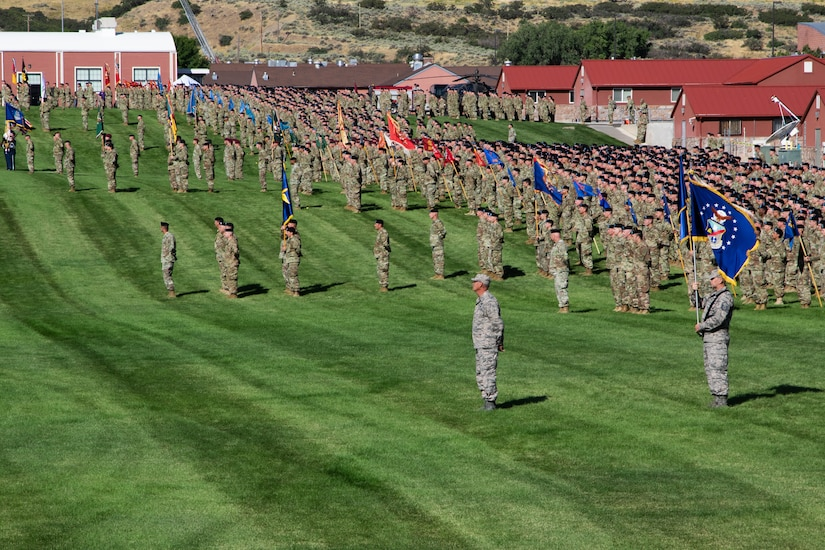 Service members in formation at Camp Williams