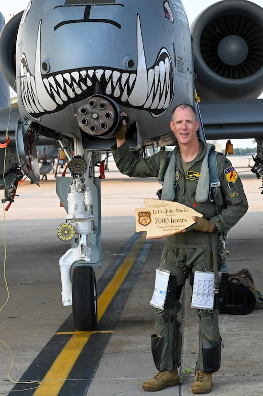 """Lt. Col. John """"Karl"""" Marks stands in front of an A-10C Thunderbolt II on Sept. 1, 2021 at Whiteman AFB, Mo. Marks reached a historic 7,000 hours in the A-10C and is the longest flying A-10 pilot to date."""