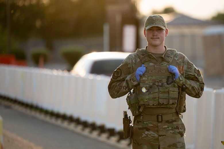 Environmental portrait featuring Security Forces airman.