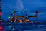 U.S. Marine Corps MV-22B's with Marine Medium Tiltrotor Squadron 265 (Reinforced), 31st Marine Expeditionary Unit (MEU), prepare for take-off aboard the amphibious assault ship USS America (LHA 6), in the Philippine Sea Aug. 17, 2021. The MV-22B provides combatant commanders with extended range and flexibility for a wide range of missions. The 31st MEU is operating aboard ships of America Expeditionary Strike Group in the 7th fleet area of operations to enhance interoperability with allies and partners and serve as a ready response force to defend peace and stability in the Indo-Pacific region.
