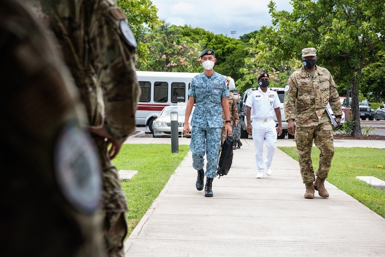 Photo of Senior Enlisted Leaders from the Indo-Pacific Region being escorted to an aircraft