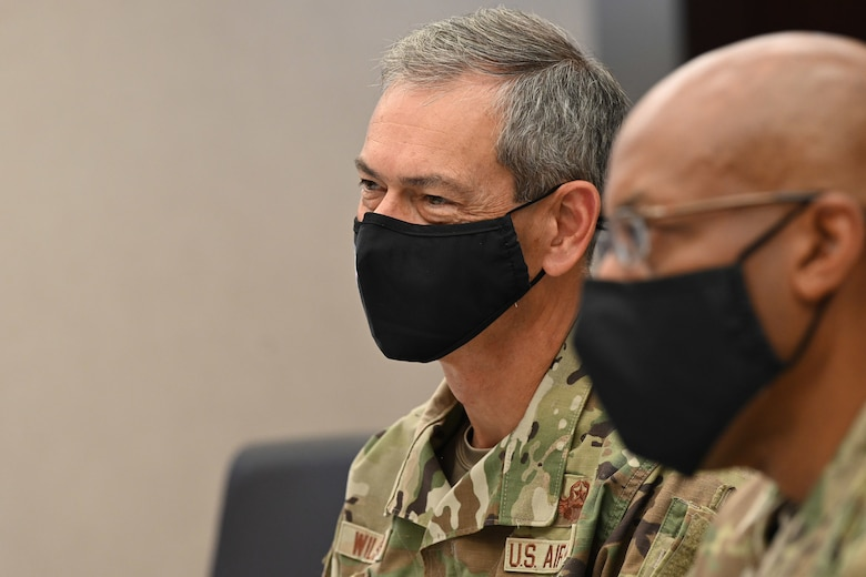Photo of a U.S. Air Force General listening during a conversation.
