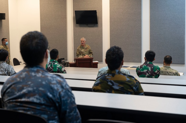 Brig. Gen. Jeremy Sloane, 36th Wing commander, speaks at the graduation of the Aircraft Maintenance Officer Course Event at Andersen Air Force Base, Guam, Aug. 20, 2021.