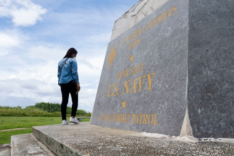 A student attending the Aircraft Maintenance Officer Course Event examines a memorial at the War in the Pacific National Park, Guam, Aug. 14, 2021.