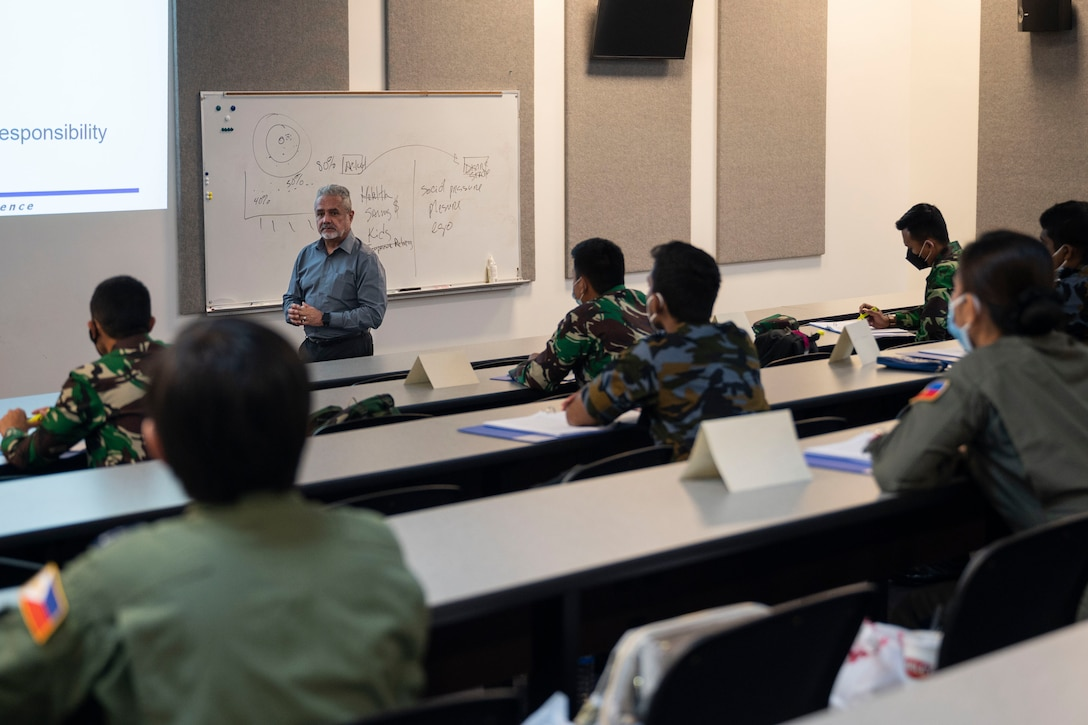 Mateo Gonzalez, an instructor at the Inter-American Air Forces Academy at Joint Base San Antonio-Lackland, Texas, teaches an Aircraft Maintenance Officer Course Event at Andersen Air Force Base, Guam, Aug. 12, 2021.