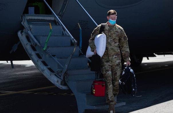 Capt. Steve Brinkley, 535th Airlift Squadron C-17 Globemaster III aircraft commander, steps off a C-17 at Joint Base Pearl Harbor-Hickam, Hawaii, Sept. 7, 2021. The aircrew, representing the 535th and 204th Airlift Squadrons, supported evacuation operations out of Afghanistan for seven days after being rerouted from temporary duty travel to Ramstein Air Base, Germany. (U.S. Air Force photo by Senior Airman Alan Ricker)