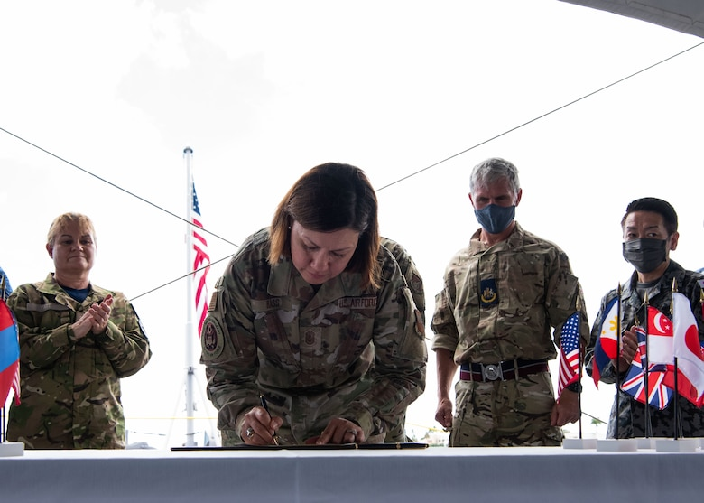 Photo of U.S. Air Force senior leader signing a document
