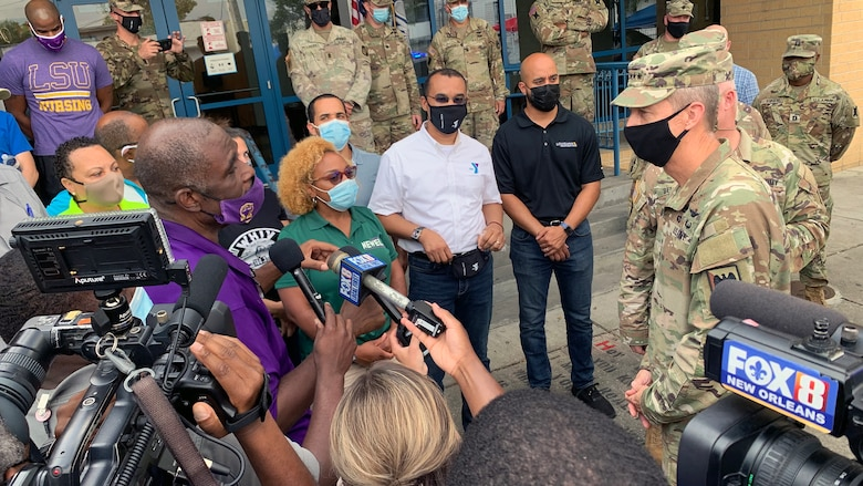 Army Gen. Daniel Hokanson, chief, National Guard Bureau, talks with community leaders during a visit to assess the Hurricane Ida response and thank troops in New Orleans Sept. 7, 2021. This image was acquired using a cellular device.