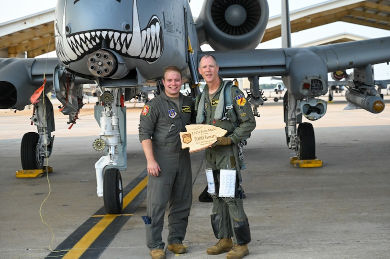 """Lt. Col. John """"Karl"""" Marks and 1st Lt. Dylan Mackey, A-10C Thunderbolt II pilots pose in front of an A-10C Thunderbolt II on Sept. 1, 2021 at Whiteman AFB, Mo. Marks, the longest flying A-10 pilot requested to fly with Mackey, the youngest pilot in the 303rd Fighter Squadron.   Photo by U.S. Air Force Maj. Shelley Ecklebe"""