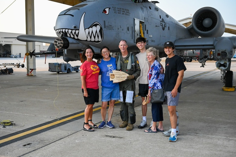 """Lt. Col. John """"Karl"""" Marks and his immediate family celebrate his 7,000 hour milestone of flying the A-10C Thunderbolt II on Sept. 1, 2021 at Whiteman AFB, Mo."""