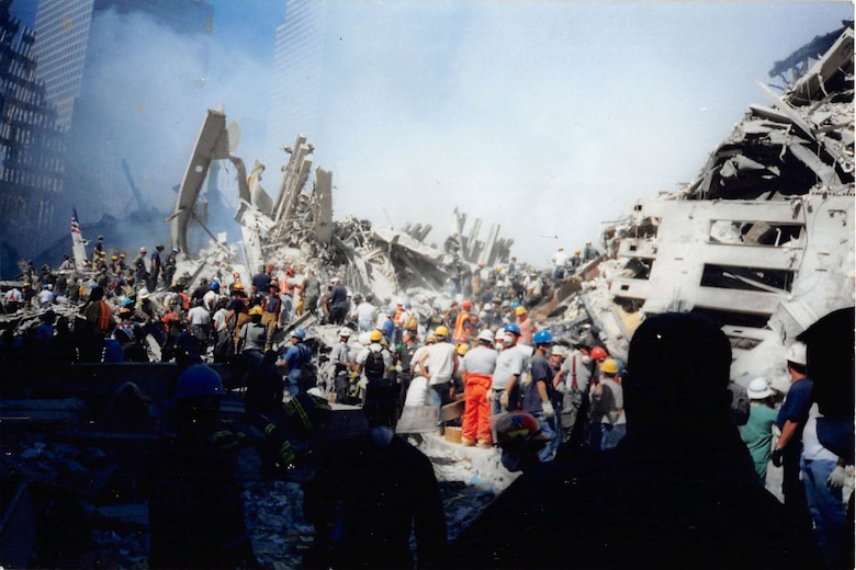 Workers remove rubble from the World Trade Center after the terrorist attack on 9/11.