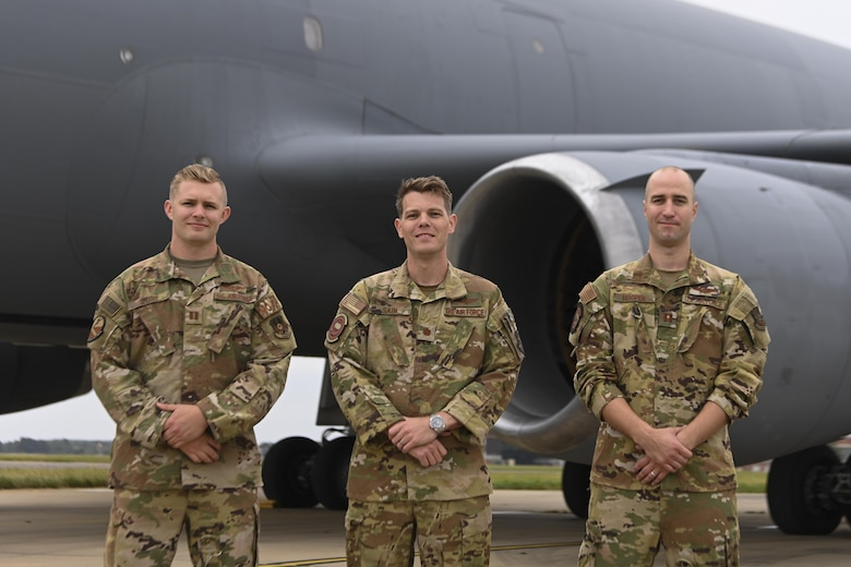 U.S. Air Force Capt. Cameron Sperry, 9th Air Refueling Squadron pilot, left, Maj. Gary Sain, 9th ARS pilot, center, and Capt. Judah Hooper, 9th ARS pilot, flew missions in support of Operation Allies Refuge from Royal Air Force Mildenhall, England. The crew assisted in the evacuation of eligible foreigners and vulnerable Afghans. (U.S. Air Force photo by Senior Airman Joseph Barron)
