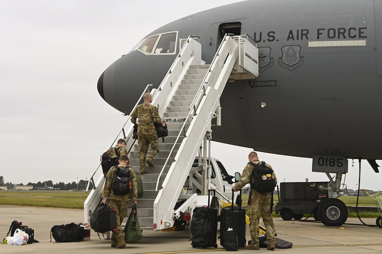 U.S. Air Force Airmen assigned to the 60th Air Mobility Wing, Travis Air Force Base, California, board a KC-10 Extender aircraft before a flight at Royal Air Force Mildenhall, England, Sept. 2, 2021. RAF Mildenhall served as a staging area for the 60th AMW in their evacuation of eligible foreigners and vulnerable Afghans during Operation Allies Refuge. (U.S. Air Force photo by Senior Airman Joseph Barron)