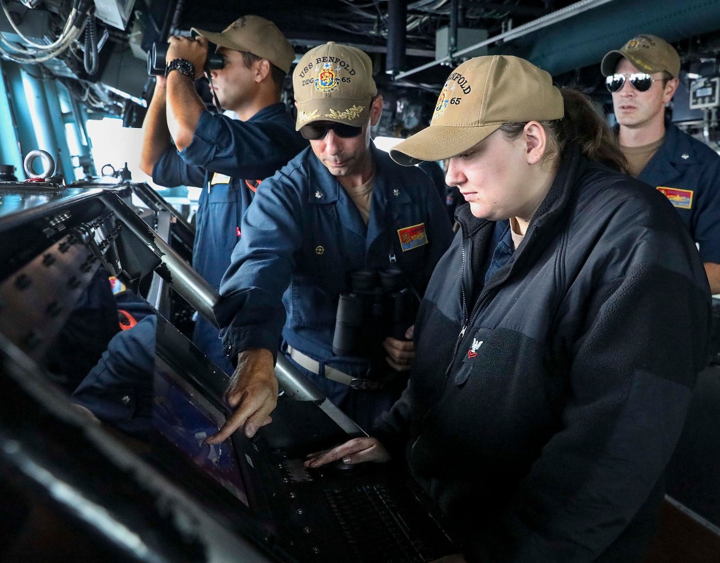 SOUTH CHINA SEA (Sept. 08, 2021) Operations Specialist 2nd Class Brittany Sopolosky, from Anderson, S.C., monitors surface contacts from the bridge of the Arleigh Burke-class guided-missile destroyer USS Benfold (DDG 65) as the ship transits the South China Sea conducting routine underway operations. Benfold is forward-deployed to the U.S. 7th Fleet area of operations in support of a free and open Indo-Pacific. (U.S. Navy photo by Mass Communication Specialist 1st Class Deanna C. Gonzales)