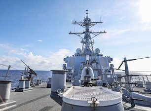 The Arleigh Burke-class guided-missile destroyer USS Benfold (DDG 65) transits the South China Sea while conducting routine underway operations.