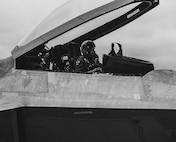A pilot sits in a jet.