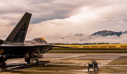 A jet is parked on the flightline.