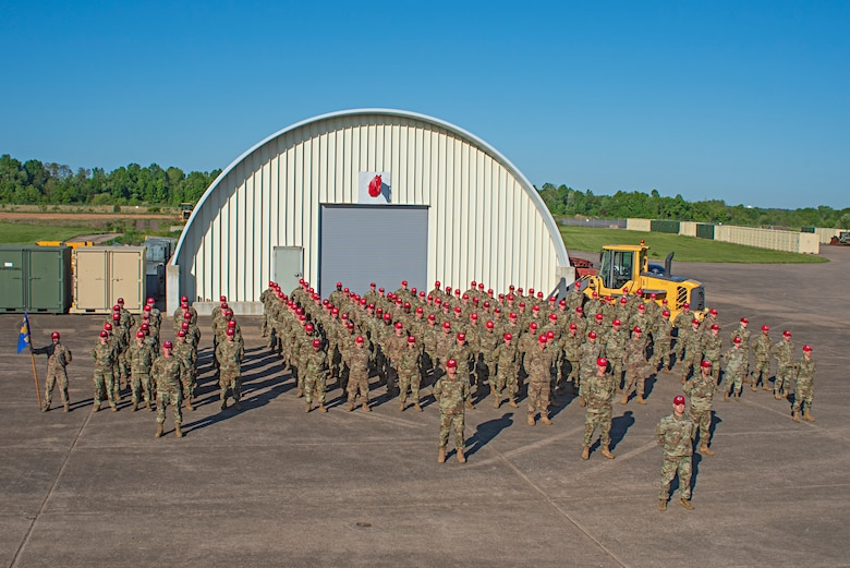 Members of the 201st Rapid Engineer Deployable Heavy Operational Repair Squadron Engineers, or REDHORSE, Detachment 1, pose for a picture at Biddle Air National Guard Base in Horsham, Pennsylvania, May 15, 2021. This is the first official group photo of the 201st REDHORSE Det. 1 in the Operational Camouflage Pattern, or OCP, utility uniform on base since they returned from their recent deployment overseas.