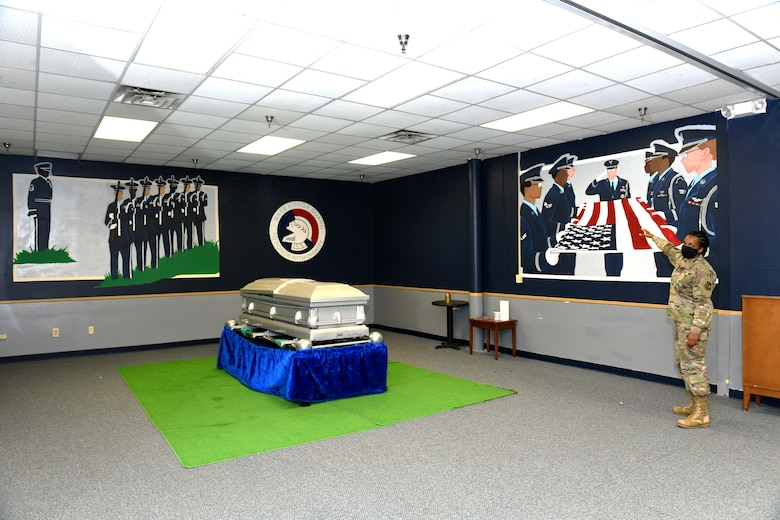 Photo shows the training room with the wall paintings depicting the honor guard.