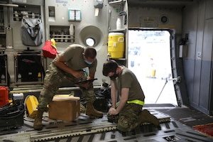 Senior Airmen Derek Reighard and Matthew Fahs, 445th Aircraft Maintenance Squadron crew chiefs, reinstall rails on a 445th Airlift Wing C-17 Globemaster III at Wright Patterson Air Force Base, Ohio Aug. 22, 2021.  Rails of the aircraft are inspected regularly for mechanical integrity and cleanliness.