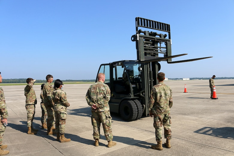 Airmen from the 445th Logistics Readiness Squadron material management flight observe a forklift in motion Aug. 22, 2021 at Wright-Patterson Air Force Base, Ohio.  The group of Airmen receiving the training were a mix of individuals that were driving a forklift for the very first time and those that were just receiving refresher training.