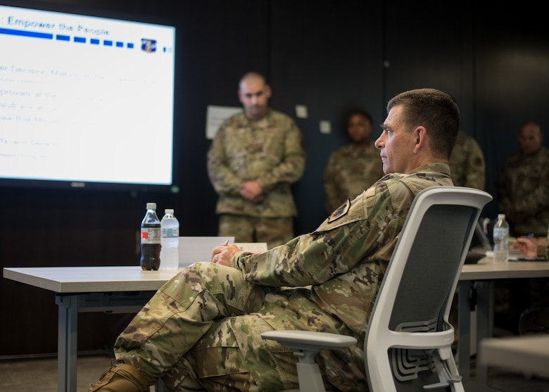 U.S. Air Force Lt. Gen. Michael A. Loh, director, Air National Guard (ANG), listens as a group of senior non-commissioned officers brief their capstone project during the Senior Noncommissioned Officer Enhancement Course at the ANG Readiness Center at Joint Base Andrews, Maryland, July 15, 2021. The first course of its kind, the curriculum is designed to empower and inspire senior enlisted leaders stationed across the 50 states, three territories, and District of Columbia to accelerate force-wide improvements and positive change. (U.S. Air National Guard photo by Tech. Sgt. Morgan R. Whitehouse)