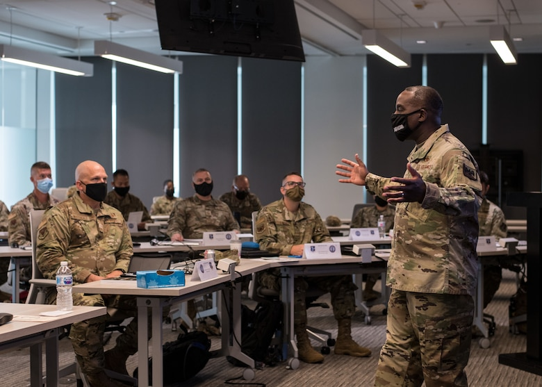 U.S. Air Force Chief Master Sgt. Maurice L. Williams, command chief, Air National Guard, speaks to senior non-commissioned officers during a welcome briefing for the Senior Noncommissioned Officer (SNCO) Enhancement Course at the ANG Readiness Center located at Joint Base Andrews, Maryland, August 31, 2021. The first course of its kind, the SNCO Enhancement Course curriculum is designed to empower and inspire enlisted leaders stationed across the 50 states, three territories and District of Columbia to accelerate force-wide improvements and positive change. (U.S. Air National Guard photo by Tech. Sgt. Morgan R. Whitehouse)