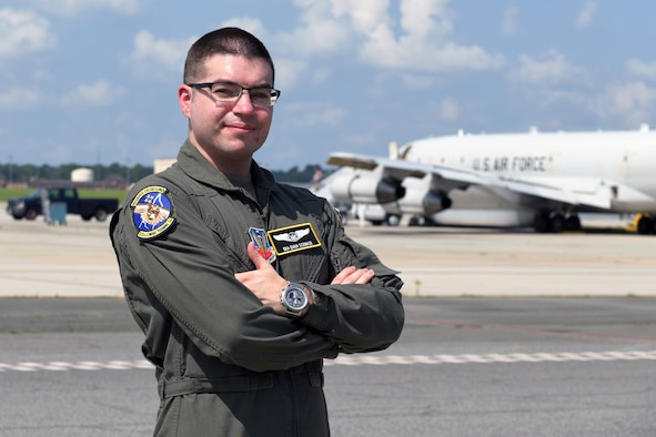 Photo shows Airman posing in front of aircraft