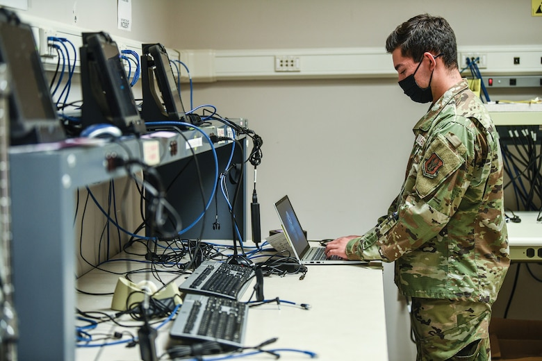 Senior Airman Charles Reano, 445th Force Support Squadron communications element client systems technician, reimages a computer Aug. 24, 2021.