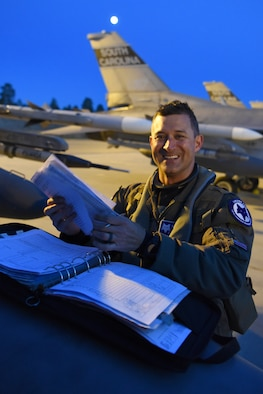 U.S. Air Force Lt. Col. Jeffrey Beckham, an F-16C Block 52 Fighting Falcon pilot assigned to the Air National Guard's 169th Fighter Wing from McEntire Joint National Guard Base, S.C., completes aircraft status records after arriving at Kallax Air Base, Luleå, Sweden, May 16, 2019 in preparation for Arctic Challenge Exercise 2019. U.S. Air Force F-16C Block 52 Fighting Falcons arrive to participate in ACE 19. ACE19 is a Nordic aviation exercise, and this year will include participation from the Swedish, Norwegian, Danish, Finnish, French, German, Dutch, British, and U.S. forces. U.S. force's participation, as part of the European Deterrence Initiative, demonstrates steadfast commitment to NATO allies and partners in Europe to remain resolute regional stability and security. (U.S. Air National Guard photo by Senior Master Sgt. Edward Snyder)