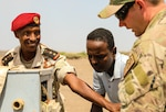 Capt. Le Mohamed Louaita, commander for Djiboutian Demining Co., expresses gratitude to Tech. Sgt. Dylan Wagner, explosive ordnance disposal technician, 123rd Airlift Wing, Aug. 22, 2021, in Djibouti City, Djibouti. Kentucky National Guard Engineers with the 577th Sapper Company and 123rd Airlift Wing traveled more than 15,000 miles to Camp Lemonnier, Djibouti, to train with the Djiboutian military demining company as a part of the State Partnership Program.