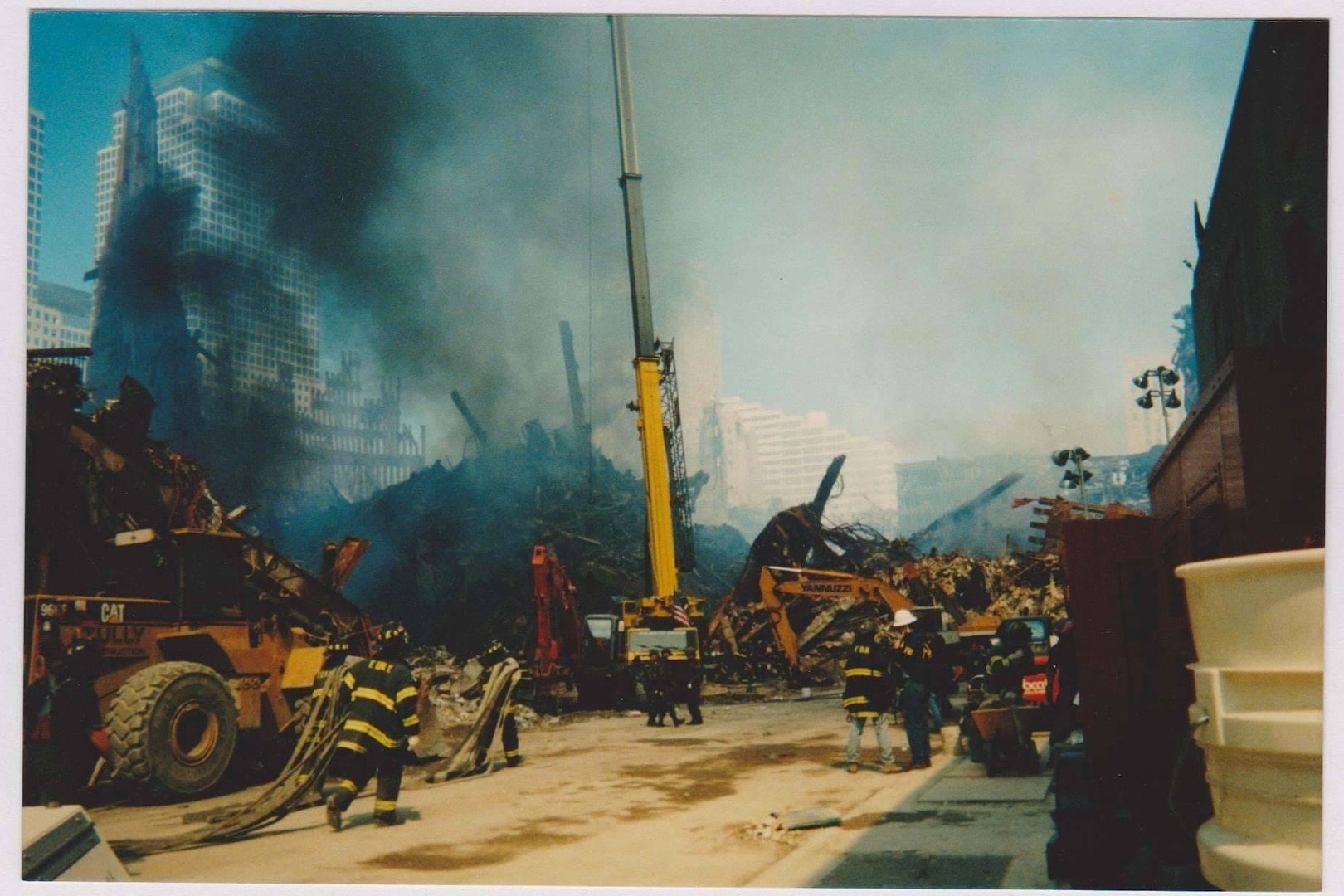 """Crews from various agencies work to clear the still smoldering """"rubble pile"""" at Ground Zero following the attack on the World Trade Center towers in New York Sept. 11, 2001. More than 14,000 New York National Guard members responded to the terrorist attacks."""