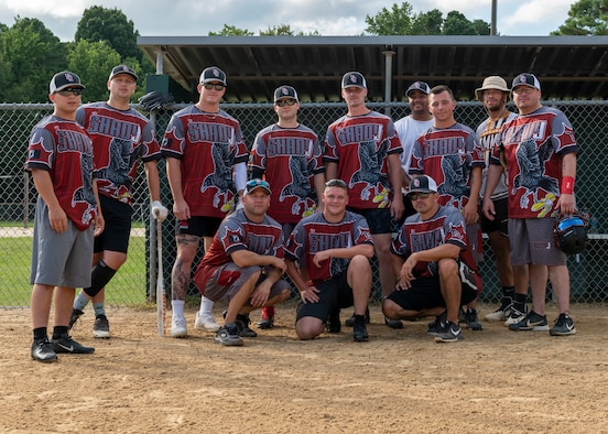 Members of Team Seymour from the 4th Munition Squadron at Seymour Johnson Air Force Base, pose for a photo prior to their softball game at Berkeley Park, North Carolina, Aug. 5, 2021.