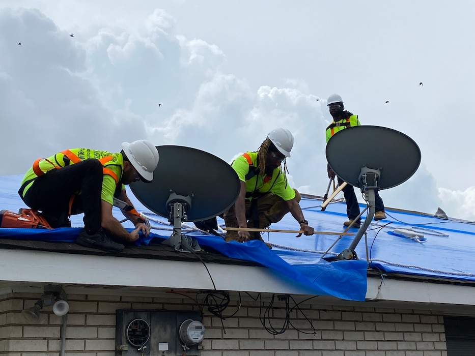 USACE contractors in New Orleans install reinforced plastic sheeting today for the first home to benefit from Operation Blue Roof since Hurricane Ida.
