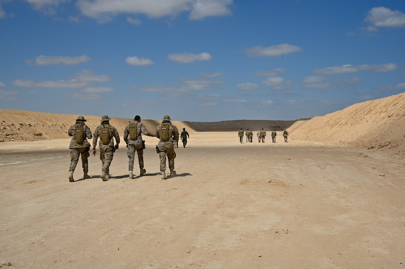 U.S., Egypt, Greece, Cyprus, Saudi Arabia and U.K special operations forces walk through the sniper range before live fire during Bright Star 21 (BS21) at Mohamed Naguib Military Base (MNMB), Egypt, Sept. 5, 2021. BS21 increases interoperability for future threat response in conventional and irregular warfare. (U.S. Army photo by Spc. Amber Cobena)