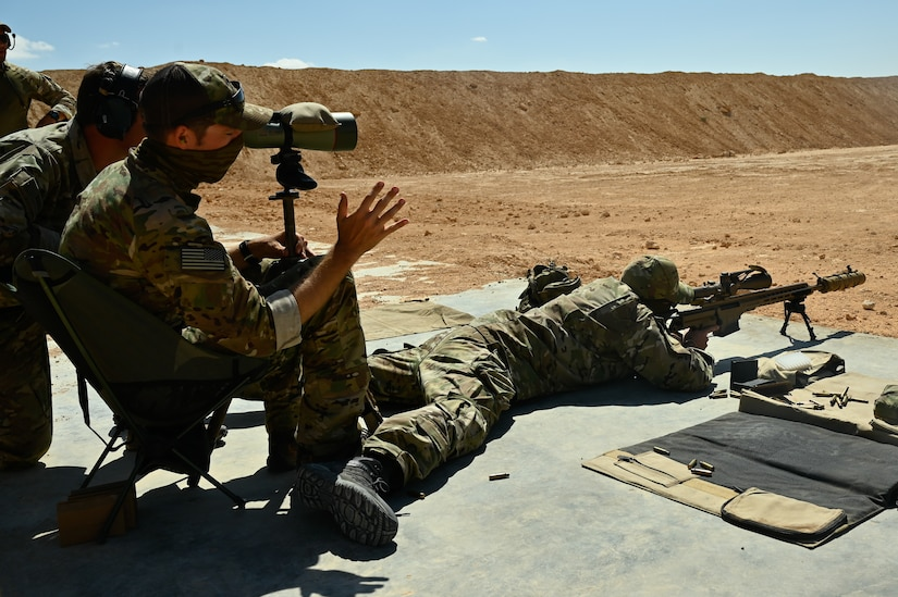 A U.S. green beret gives guidance on firing techniques to a partner nation special operator at a sniper range during Bright Star 21 (BS21) at Mohamed Naguib Military Base (MNMB), Egypt, Sept. 5, 2021. BS21 increases interoperability for future threat response in conventional and irregular warfare. (U.S. Army photo by Spc. Amber Cobena)
