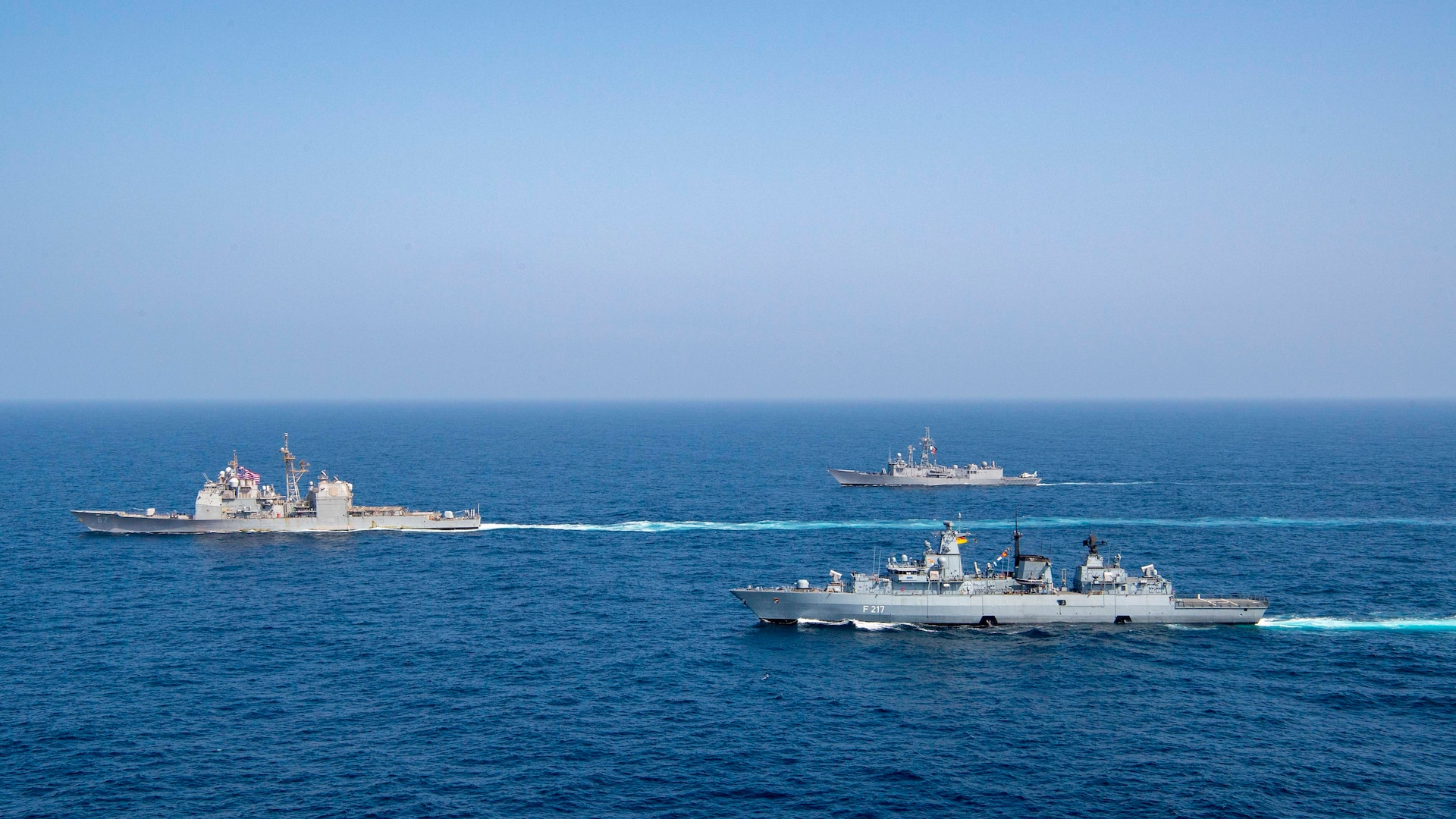 ARABIAN SEA (Sept. 6, 2021) The Pakistan Navy frigate PNS Alamgir (F 260), German Navy frigate FGS Bayern (F 217), and guided-missile cruiser USS Shiloh (CG 67) sail in formation during a passing exercise (PASSEX) in the Arabian Sea, Sept. 6. The exercise included advanced maneuvers and communication drills flexing the crews' abilities to operate together in a dynamic environment, and test and refine combined command and control processes. (U.S. Navy photo by Mass Communication Specialist 1st Class Rawad Madanat)