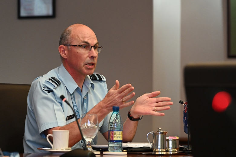 Photo of a leader from the Royal New Zealand Air Force speaking.