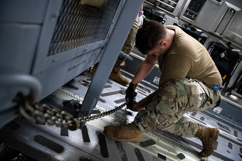 Photo of Airman loading equipment onto an aircraft