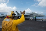 """An F/A-18E Super Hornet assigned to the """"Golden Dragons"""" of Strike Fighter Squadron (VFA) 192 prepares to launch off the flight deck aboard Nimitz-class aircraft carrier USS Carl Vinson (CVN 70). Carl Vinson Carrier Strike Group is on a scheduled deployment in the U.S. 7th Fleet area of operations to enhance interoperability with allies and partners while serving as a ready-response force in support of a free and open Indo-Pacific region."""