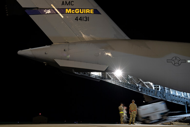 Photo of Airmen loading an aircraft