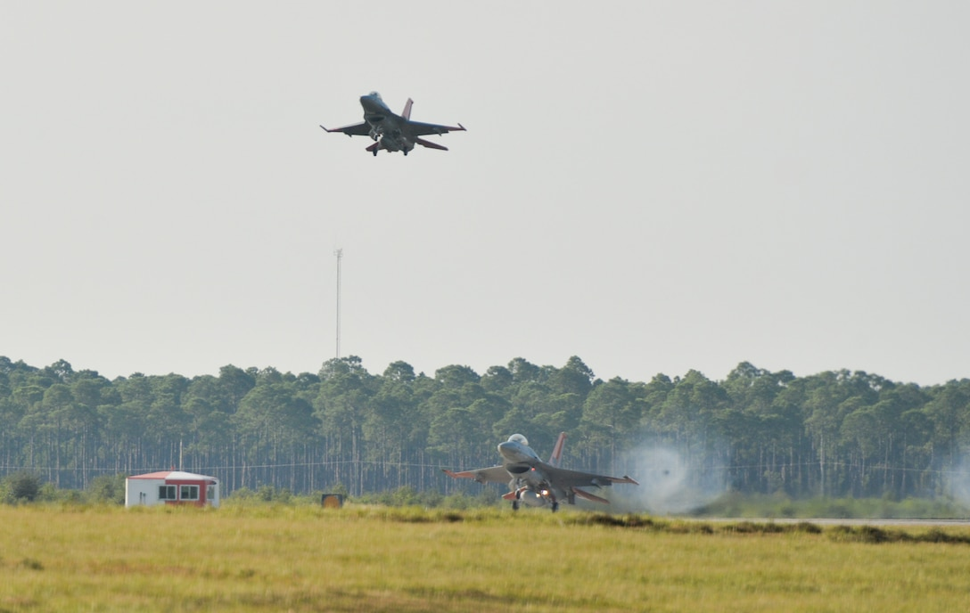 A U.S. Air Force QF-16 drone assigned to the 82d Aerial Targets Squadron lands at Tyndall Air Force Base, Florida, Aug. 26, 2021. Up to four QF-16s can be remotely controlled by a single pilot capable of performing precise maneuvers to simulate an adversary fighter during training exercises. (U.S. Air Force photo by Staff Sgt. Stefan Alvarez)