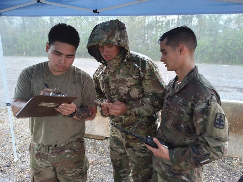 Sgt. Joemicheal Cristobal, Spc. Osias Passi, and Spc. Brennon Westfall, members of the Alaska Army National Guard and Task Force-Alaska, log trailer and driver information on a yard dog sheet, at a transportation yard in Roseland, Louisiana, Sept. 7, 2021. 17 Alaska Guardsmen are assisting the Louisiana National Guard's support to civil authorities in the aftermath of Hurricane Ida, which struck the state Aug. 29, leaving disaster, destruction and flooding in its wake. (U.S. Army National Guard photo by Staff Sgt. Jacob Tyrrell)