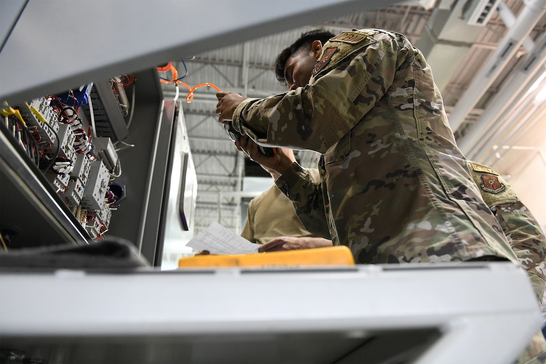 Senior Airman Nishit Macwan, 741st Maintenance Squadron power, refrigeration and electrical laboratory technician, troubleshoots a missile alert facility chiller during the Global Strike Challenge July 26, 2021, at Malmstrom Air Force Base, Mont. PREL Airmen are specialists in electrical and refrigeration troubleshooting and repair. (U.S. Air Force photo by Airman Elijah Van Zandt)