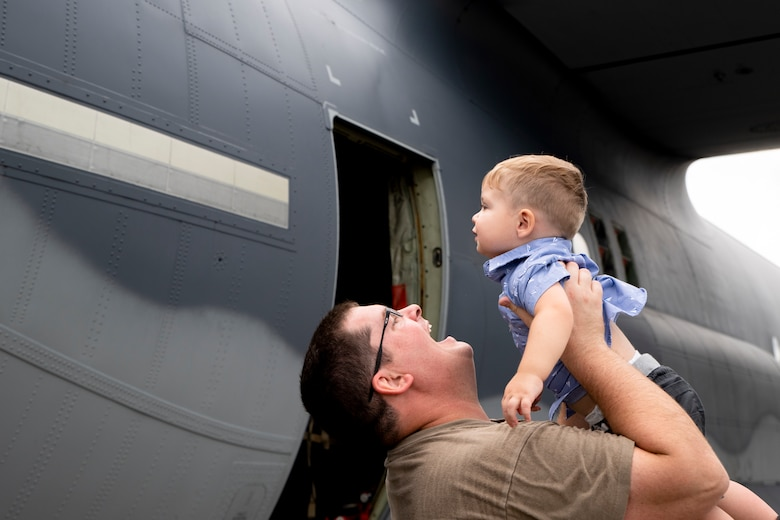 Photo of an Airman holding his child
