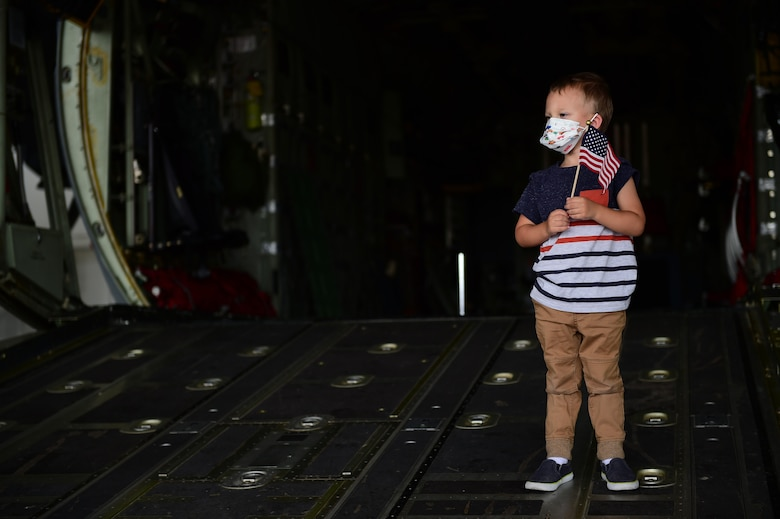 Photo of child on the ramp of an aircraft